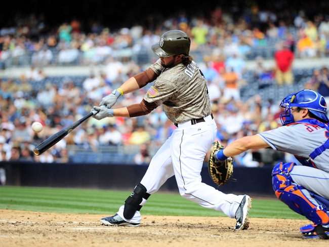 Aug 18, 2013; San Diego, CA, USA; San Diego Padres left fielder Jaff Decker (1) flies out with the bases loaded to end the eighth inning against the New York Mets at Petco Park. Mandatory Credit: Christopher Hanewinckel-USA TODAY Sports