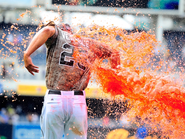 Aug 18, 2013; San Diego, CA, USA; San Diego Padres center fielder Will Venable (25) is dumped with Powerade by catcher Nick Hundley (right) after hitting a walk-off home run in the ninth inning to beat the New York Mets 4-3 at Petco Park. Mandatory Credit: Christopher Hanewinckel-USA TODAY Sports