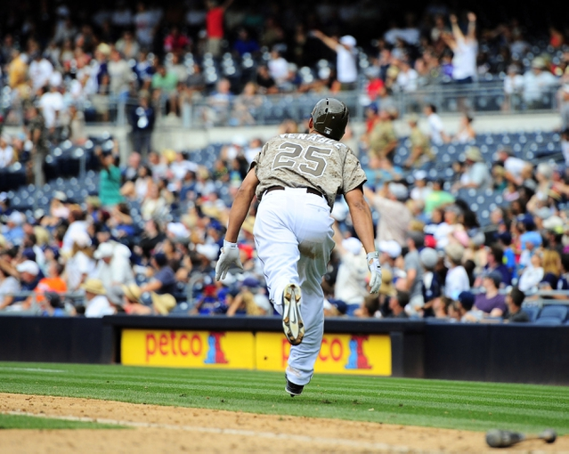 Aug 18, 2013; San Diego, CA, USA; San Diego Padres right fielder Will Venable (25) watches the game winning home run down the right field line during the ninth inning against the New York Mets at Petco Park. The Padres won 4-3. Mandatory Credit: Christopher Hanewinckel-USA TODAY Sports