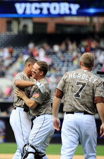 Aug 18, 2013; San Diego, CA, USA; San Diego Padres right fielder Will Venable (left) celebrates with catcher Nick Hundley (center) and third baseman Chase Headley (7) following the game winning home run during the ninth inning against the New York Mets at Petco Park. The Padres won 4-3. Mandatory Credit: Christopher Hanewinckel-USA TODAY Sports