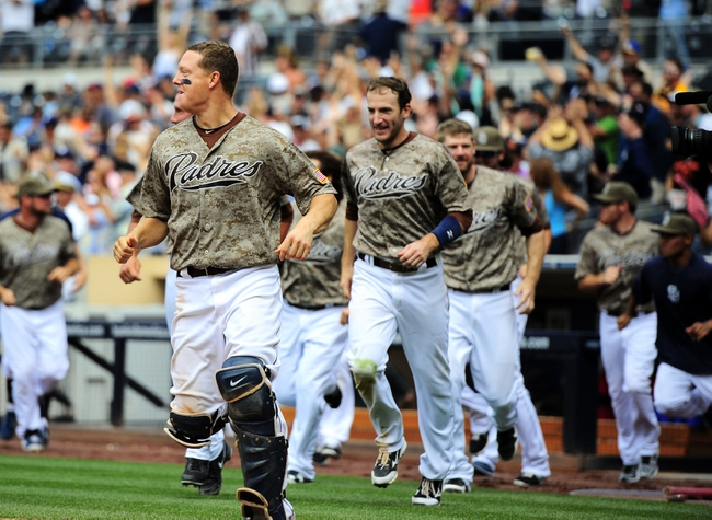 Aug 18, 2013; San Diego, CA, USA; San Diego Padres players run to home plate after a walk off home run by San Diego Padres center fielder Will Venable (not pictured) against the New York Mets at Petco Park. The Padres won 4-3. Mandatory Credit: Christopher Hanewinckel-USA TODAY Sports