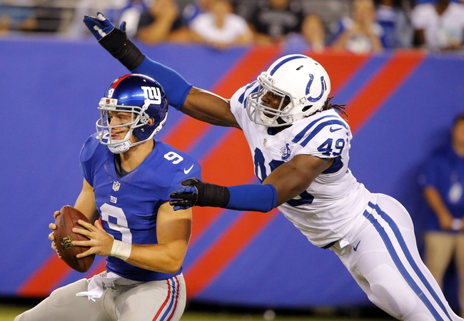 Aug 18, 2013; East Rutherford, NJ, USA; Indianapolis Colts linebacker Caesar Rayford (49) sacks New York Giants quarterback Ryan Nassib (9) during the second half at MetLife Stadium. Indianapolis Colts defeat the New York Giants 20-12. Mandatory Credit: Jim O'Connor-USA TODAY Sports