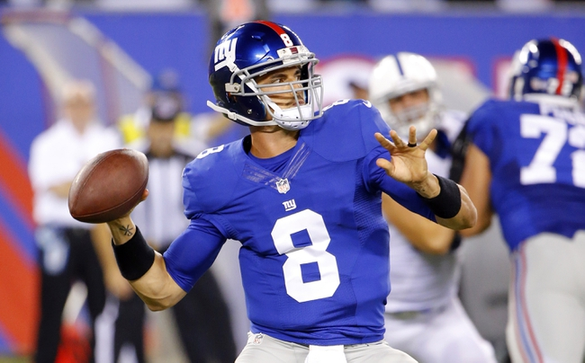 Aug 18, 2013; East Rutherford, NJ, USA; New York Giants quarterback David Carr (8) during the second half against the Indianapolis Colts at MetLife Stadium. Indianapolis Colts defeat the New York Giants 20-12. Mandatory Credit: Jim O'Connor-USA TODAY Sports