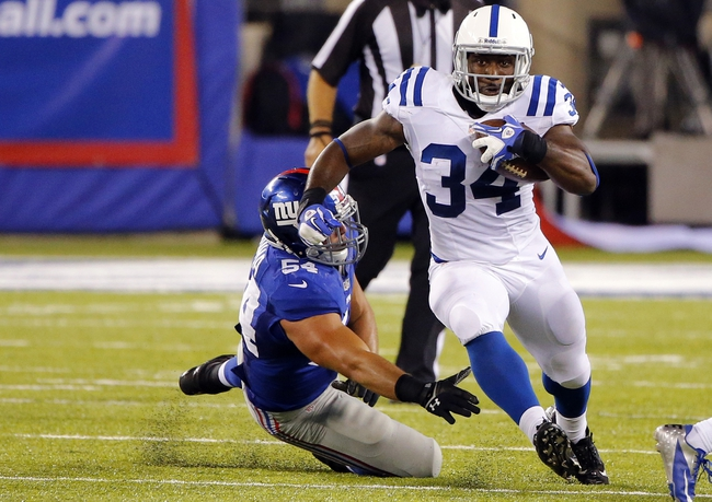 Aug 18, 2013; East Rutherford, NJ, USA; Indianapolis Colts running back Delone Carter (34) gets by New York Giants defensive end Matt Broha (54) during the second half at MetLife Stadium. Indianapolis Colts defeat the New York Giants 20-12. Mandatory Credit: Jim O'Connor-USA TODAY Sports