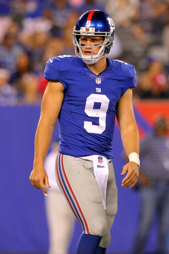 Aug 18, 2013; East Rutherford, NJ, USA; New York Giants quarterback Ryan Nassib (9) walks to the huddle against the Indianapolis Colts during the fourth quarter of a preseason game at MetLife Stadium. The colts defeated the Giants 20-12. Mandatory Credit: Brad Penner-USA TODAY Sports