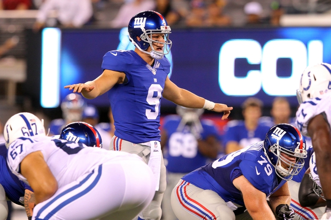 Aug 18, 2013; East Rutherford, NJ, USA; New York Giants quarterback Ryan Nassib (9) audibles at the line against the Indianapolis Colts during the fourth quarter of a preseason game at MetLife Stadium. The colts defeated the Giants 20-12. Mandatory Credit: Brad Penner-USA TODAY Sports