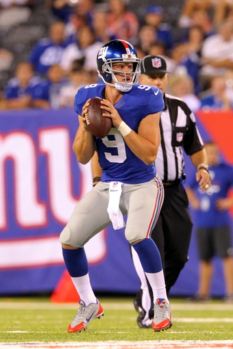 Aug 18, 2013; East Rutherford, NJ, USA; New York Giants quarterback Ryan Nassib (9) drops back to pass against the Indianapolis Colts during the fourth quarter of a preseason game at MetLife Stadium. The colts defeated the Giants 20-12. Mandatory Credit: Brad Penner-USA TODAY Sports