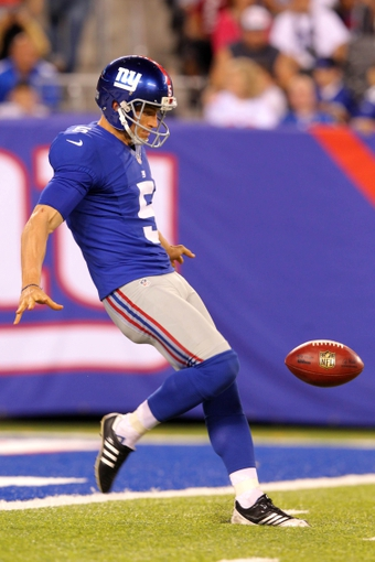 Aug 18, 2013; East Rutherford, NJ, USA; New York Giants punter Steve Weatherford (5) punts against the Indianapolis Colts during the fourth quarter of a preseason game at MetLife Stadium. The colts defeated the Giants 20-12. Mandatory Credit: Brad Penner-USA TODAY Sports