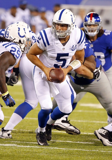 Aug 18, 2013; East Rutherford, NJ, USA; Indianapolis Colts quarterback Chandler Harnish (5) gets ready to hand off during the second half against the New York Giants at MetLife Stadium. Indianapolis Colts defeat the New York Giants 20-12. Mandatory Credit: Jim O'Connor-USA TODAY Sports