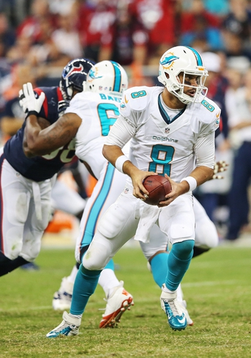 Aug 17, 2013; Houston, TX, USA; Miami Dolphins quarterback Matt Moore (8) hands off during the game against the Houston Texans at Reliant Stadium. The Texans won 24-17. Mandatory Credit: Kevin Jairaj-USA TODAY Sports