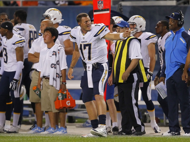 Aug 15, 2013; Chicago, IL, USA; San Diego Chargers quarterback Philip Rivers (17) signals to an official during the second half against the Chicago Bears at Soldier Field. Chicago won 33-28. Mandatory Credit: Dennis Wierzbicki-USA TODAY Sports