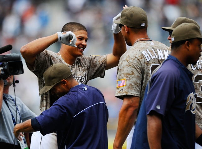 Aug 18, 2013; San Diego, CA, USA; San Diego Padres center fielder Will Venable (25) celebrates after a 4-3 walk off win against the New York Mets at Petco Park. Mandatory Credit: Christopher Hanewinckel-USA TODAY Sports