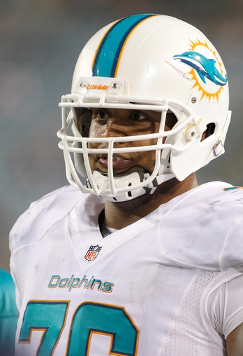 Aug 9, 2013; Jacksonville, FL, USA; Miami Dolphins defensive tackle A.J. Francis (76) during the second half against the Jacksonville Jaguars at EverBank Field. Miami Dolphins defeated the Jacksonville Jaguars 27-3. Mandatory Credit: Kim Klement-USA TODAY Sports