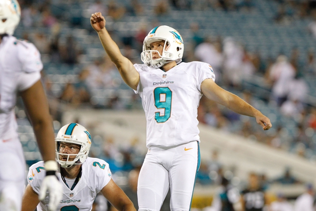 Aug 9, 2013; Jacksonville, FL, USA; Miami Dolphins kicker Caleb Sturgis (9) kicks a field goal during the second half against the Jacksonville Jaguars at EverBank Field. Miami Dolphins defeated the Jacksonville Jaguars 27-3. Mandatory Credit: Kim Klement-USA TODAY Sports