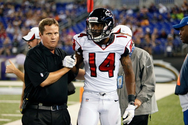 Aug 15, 2013; Baltimore, MD, USA; Atlanta Falcons wide receiver Martel Moore (14) is helped off the field by medical personnel following an injury against the Baltimore Ravens at M&T Bank Stadium. Mandatory Credit: Mitch Stringer-USA TODAY Sports