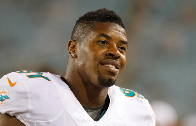 Aug 9, 2013; Jacksonville, FL, USA; Miami Dolphins defensive end Cameron Wake (91) during the second half against the Jacksonville Jaguars at EverBank Field. Miami Dolphins defeated the Jacksonville Jaguars 27-3. Mandatory Credit: Kim Klement-USA TODAY Sports