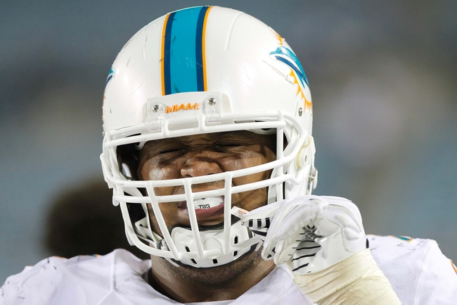 Aug 9, 2013; Jacksonville, FL, USA; Miami Dolphins defensive tackle A.J. Francis (76) smells salt before he goes on the field during the second half against the Jacksonville Jaguars at EverBank Field. Miami Dolphins defeated the Jacksonville Jaguars 27-3. Mandatory Credit: Kim Klement-USA TODAY Sports