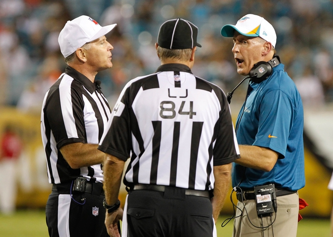 Aug 9, 2013; Jacksonville, FL, USA; Miami Dolphins head coach Joe Philbin reacts as he talks with the referees during the second half against the Jacksonville Jaguars at EverBank Field. Miami Dolphins defeated the Jacksonville Jaguars 27-3. Mandatory Credit: Kim Klement-USA TODAY Sports