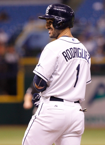 Aug 15, 2013; St. Petersburg, FL, USA; Tampa Bay Rays left fielder Sean Rodriguez (1) smiles after he singled against the Seattle Mariners at Tropicana Field. Mandatory Credit: Kim Klement-USA TODAY Sports