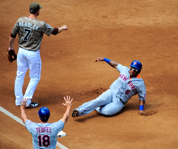 Aug 18, 2013; San Diego, CA, USA; New York Mets right fielder Marlon Byrd (6) slides safely into third base during the fourth inning against the San Diego Padres at Petco Park. Mandatory Credit: Christopher Hanewinckel-USA TODAY Sports