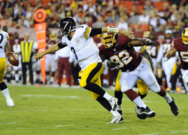 Aug 19, 2013; Landover, MD, USA; Pittsburgh Steelers quarterback Landry Jones (3) fumbles the ball as Washington Redskins nose tackle Chris Baker (92) chases during the second half at FedEX Field. Mandatory Credit: Brad Mills-USA TODAY Sports