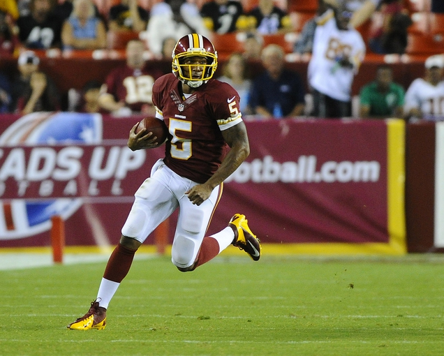 Aug 19, 2013; Landover, MD, USA; Washington Redskins quarterback Pat White (5) runs the ball during the second half against the Pittsburgh Steelers at FedEX Field. Mandatory Credit: Brad Mills-USA TODAY Sports
