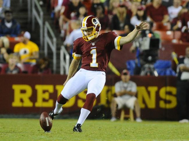 Aug 19, 2013; Landover, MD, USA; Washington Redskins kicker John Potter kicks off against the Pittsburgh Steelers during the second half at FedEX Field. Mandatory Credit: Brad Mills-USA TODAY Sports