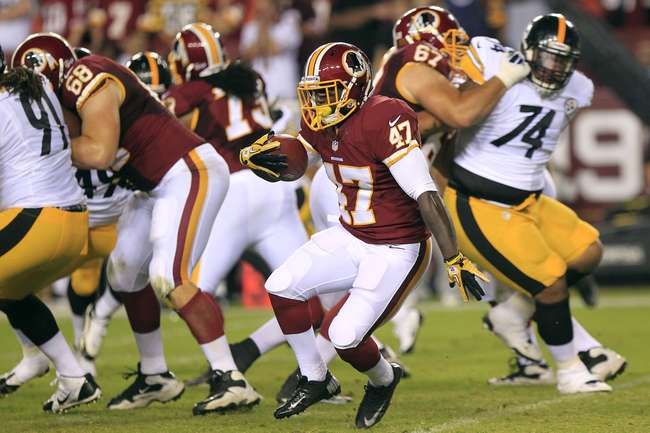 Aug 19, 2013; Landover, MD, USA; Washington Redskins running back Jawan Jamison (47) carries the ball against the Pittsburgh Steelers in the third quarter at FedEx Field. The Redskins won 24-13. Mandatory Credit: Geoff Burke-USA TODAY Sports