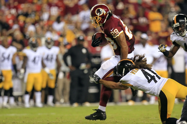Aug 19, 2013; Landover, MD, USA; Washington Redskins running back Roy Helu (29) runs with the ball to score a touchdown as Pittsburgh Steelers defensive back Ross Ventrone (41) defends in the fourth quarter at FedEx Field. The Redskins won 24-13. Mandatory Credit: Geoff Burke-USA TODAY Sports
