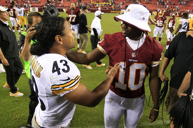 Aug 19, 2013; Landover, MD, USA; Pittsburgh Steelers strong safety Troy Polamalu (43) talks with Washington Redskins quarterback Robert Griffin III (10) after their game at FedEx Field. The Redskins won 24-13. Mandatory Credit: Geoff Burke-USA TODAY Sports
