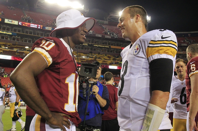 Aug 19, 2013; Landover, MD, USA; Washington Redskins quarterback Robert Griffin III (10) talks with Pittsburgh Steelers quarterback Landry Jones (3) after their game at FedEx Field. The Redskins won 24-13. Mandatory Credit: Geoff Burke-USA TODAY Sports