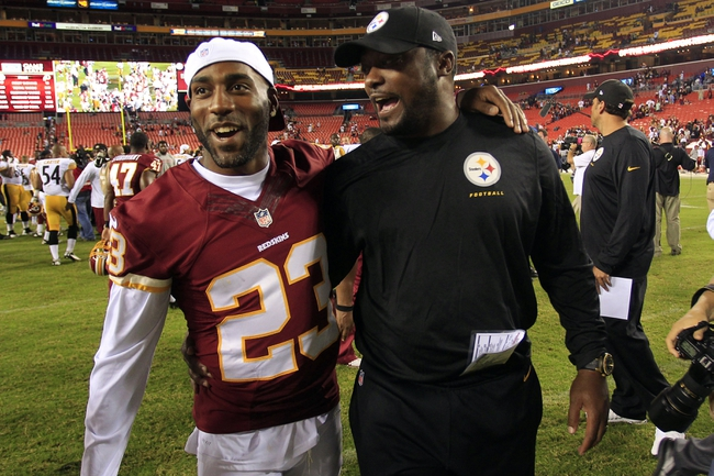 Aug 19, 2013; Landover, MD, USA; Washington Redskins cornerback DeAngelo Hall (23) talks with Pittsburgh Steelers head coach Mike Tomlin after their game at FedEx Field. The Redskins won 24-13. Mandatory Credit: Geoff Burke-USA TODAY Sports