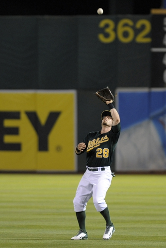 Aug 19, 2013; Oakland, CA, USA; Oakland Athletics second baseman Eric Sogard (28) catches a pop fly during the fifth inning against the Seattle Mariners at O.Co Coliseum. Mandatory Credit: Ed Szczepanski-USA TODAY Sports