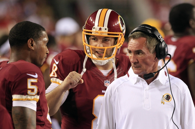 Aug 19, 2013; Landover, MD, USA; Washington Redskins head coach Mike Shanahan (right) talks with quarterback Pat White (5) on the sidelines as quarterback Rex Grossman (8) looks on against the Pittsburgh Steelers in the fourth quarter at FedEx Field. The Redskins won 24-13. Mandatory Credit: Geoff Burke-USA TODAY Sports