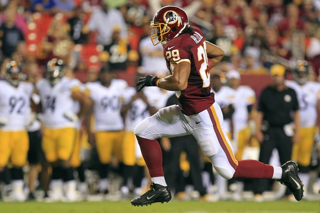 Aug 19, 2013; Landover, MD, USA; Pittsburgh Steelers running back Jonathan Dwyer (27) runs with the ball as Washington Redskins safety Bacarri Rambo (29) defends in the second quarter at FedEx Field. Mandatory Credit: Geoff Burke-USA TODAY Sports