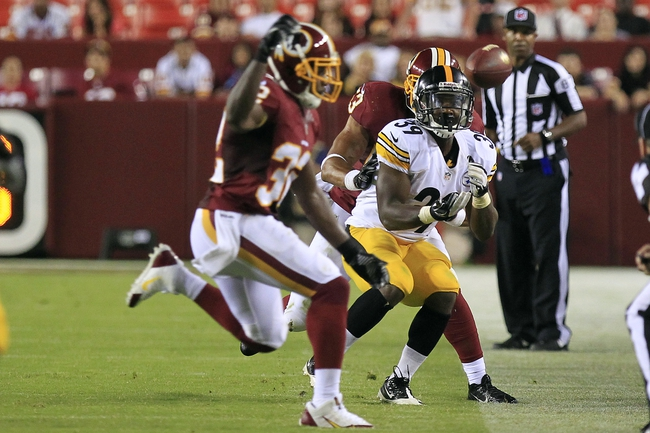 Aug 19, 2013; Landover, MD, USA; Pittsburgh Steelers cornerback Isaiah Green (39) attempts to catch the ball as Washington Redskins linebacker Bryan Kehl (53) defends in the fourth quarter at FedEx Field. The Redskins won 24-13. Mandatory Credit: Geoff Burke-USA TODAY Sports