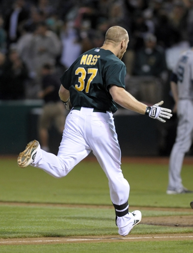 Aug 19, 2013; Oakland, CA, USA; Oakland Athletics first baseman Brandon Moss (37) rounds the bases after hitting a walk off home run against the Seattle Mariners during the ninth inning at O.Co Coliseum. The Oakland Athletics defeated the Seattle Mariners 2-1. Mandatory Credit: Ed Szczepanski-USA TODAY Sports