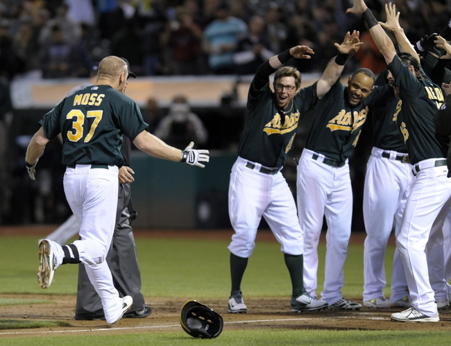 Aug 19, 2013; Oakland, CA, USA; Oakland Athletics first baseman Brandon Moss (37) celebrates after hitting a walk off home run during the ninth inning against the Seattle Mariners at O.Co Coliseum. The Oakland Athletics defeated the Seattle Mariners 2-1. Mandatory Credit: Ed Szczepanski-USA TODAY Sports