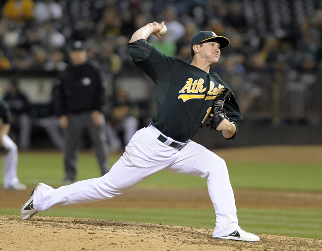 Aug 19, 2013; Oakland, CA, USA; Oakland Athletics starting pitcher Jarrod Parker (11) pitches against the Seattle Mariners during the ninth inning at O.Co Coliseum. The Oakland Athletics defeated the Seattle Mariners 2-1. Mandatory Credit: Ed Szczepanski-USA TODAY Sports