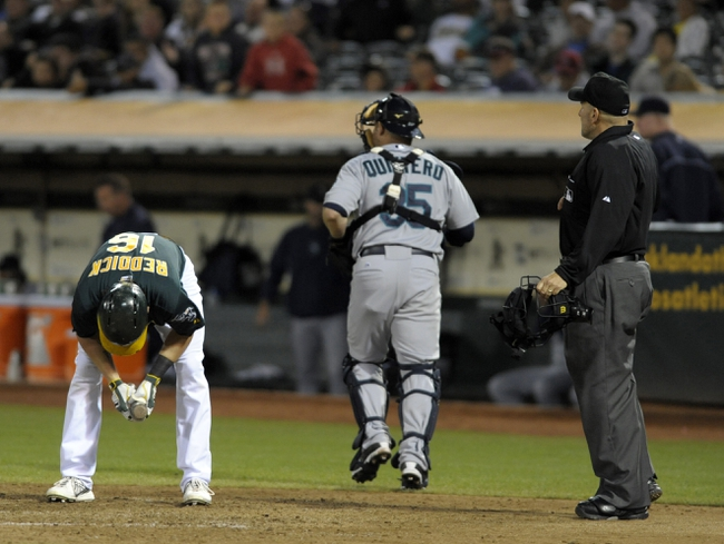 Aug 19, 2013; Oakland, CA, USA; Oakland Athletics right fielder Josh Reddick (16) reacts after striking out during the eighth inning of the game against the Seattle Mariners at O.Co Coliseum. The Oakland Athletics defeated the Seattle Mariners 2-1. Mandatory Credit: Ed Szczepanski-USA TODAY Sports