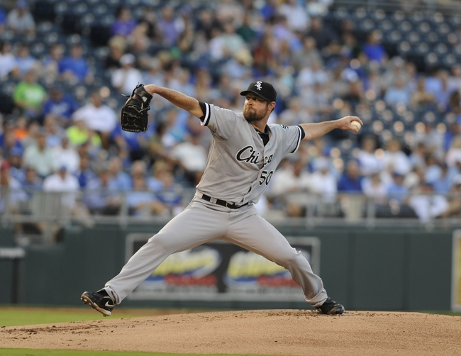 Aug 20, 2013; Kansas City, MO, USA; Chicago White Sox starting pitcher John Danks (50) delivers a pitch in the first inning against the Kansas City Royals at Kauffman Stadium. Mandatory Credit: John Rieger-USA TODAY Sports