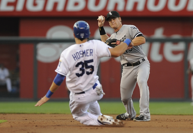 Aug 20, 2013; Kansas City, MO, USA; Chicago White Sox second baseman Gordon Beckham (15) turns a double play as Kansas City Royals first baseman Eric Hosmer (25) is out at second base in the first inning at Kauffman Stadium. Mandatory Credit: John Rieger-USA TODAY Sports
