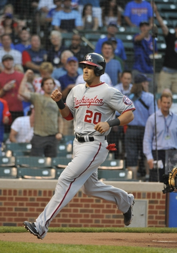 Aug 20, 2013; Chicago, IL, USA; Washington Nationals shortstop Ian Desmond (20) scores as against the Chicago Cubs  during the first inning at Wrigley Field. Mandatory Credit: David Banks-USA TODAY Sports