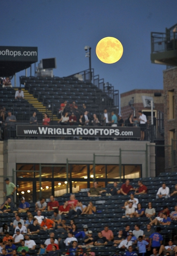 Aug 20, 2013; Chicago, IL, USA; A full moon rises over the rooftops at Wrigley Field during a game between the Chicago Cubs and the Washington Nationals.. Mandatory Credit: David Banks-USA TODAY Sports