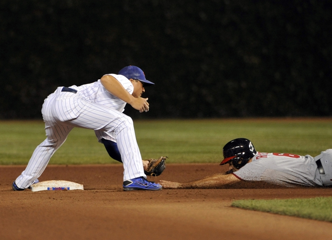 Aug 20, 2013; Chicago, IL, USA; Washington Nationals second baseman Anthony Rendon (6) is tagged out by Chicago Cubs second baseman Darwin Barney (15) on a steal attempt during the fourth inning at Wrigley Field. Mandatory Credit: David Banks-USA TODAY Sports