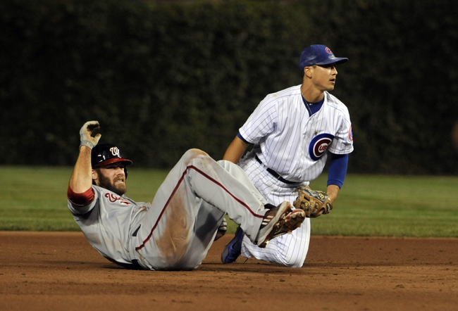 Aug 20, 2013; Chicago, IL, USA; Washington Nationals right fielder Jayson Werth (28) over runs second base as Chicago Cubs second baseman Darwin Barney (15) tags him out during the sixth inning at Wrigley Field. Mandatory Credit: David Banks-USA TODAY Sports