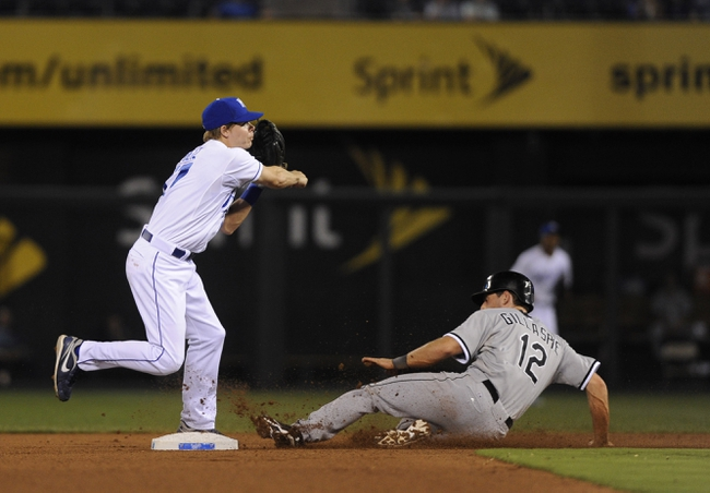 Aug 20, 2013; Kansas City, MO, USA; Chicago White Sox third baseman Conor Gillaspie (12) is out at second base as Kansas City Royals second baseman Chris Getz (17) turns a double play in the seventh inning at Kauffman Stadium. Mandatory Credit: John Rieger-USA TODAY Sports