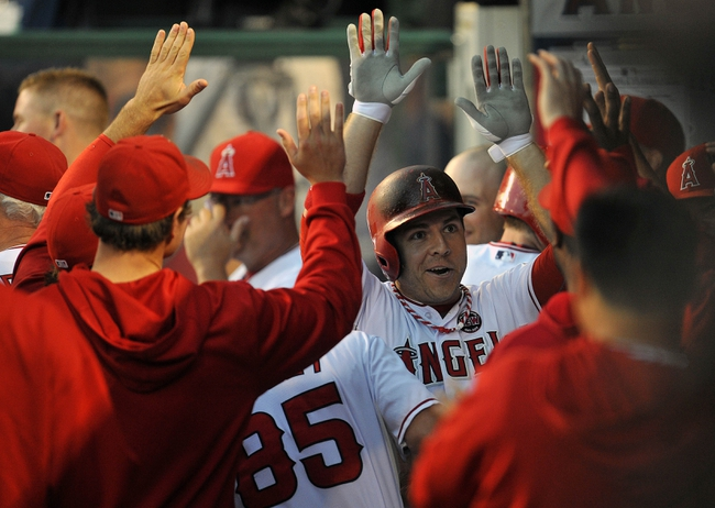 August 20, 2013; Anaheim, CA, USA; Los Angeles Angels left fielder J.B. Shuck (39) is greeted after hitting a solo home run in the first inning against the Cleveland Indians at Angel Stadium of Anaheim. Mandatory Credit: Gary A. Vasquez-USA TODAY Sports