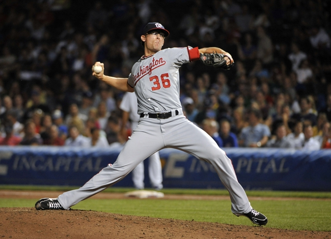 Aug 20, 2013; Chicago, IL, USA; Washington Nationals relief pitcher Tyler Clippard (36) pitches against the Chicago Cubs during the