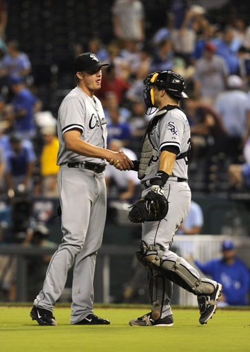 Aug 20, 2013; Kansas City, MO, USA; Chicago White Sox relief pitcher Addison Reed (43) celebrates with catcher Josh Phegley (36) after the game against the Kansas City Royals at Kauffman Stadium. Chicago won the game 2-0. Mandatory Credit: John Rieger-USA TODAY Sports